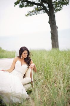 #Bride | Wedding Gown by #Enzoani | Kelly Sweet Photography | #SMP Weddings: http://www.stylemepretty.com/2013/12/04/michigan-backyard-beach-wedding-from-kelly-sweet-photography/