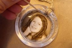 I love that this is a clear frame... Tree lights can show through.  Photo ornament made from plastic shower curtain ring