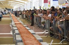 Here's a Picture of the World's Longest Pizza, Try Not to Cry Too Hard  - Delish.com