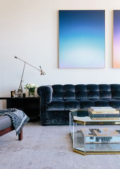 big colorful art, interesting sofa and side tables