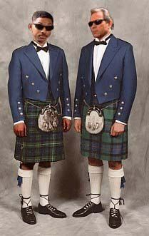 Two men wearing matching outfit, in kilts.