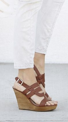 Brown leather wedge sandals with a stacked platform heel