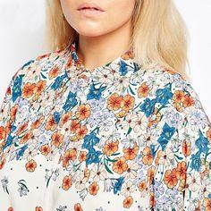 Moda Roupas Plus Size para mulheres de tamanho grande Calitta. Camisa de Botões Casual Feminina Floral Plus Size Branca Colorida. Compre roupas online nas Lojas Calitta.