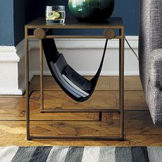 Designed by SAIC student Brooke Collins, the Sling Nightstand is crafted of iron with a hand-applied brass finish. It's perfect for suspending magazines and other small objects in air. (via @cb2pins)