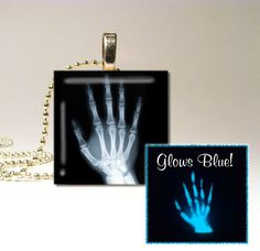 Glow in the Dark Skeleton X-ray Hand Necklace by LittleGemGirl