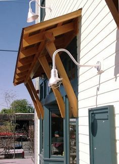 Country style overhang and goose neck light.
