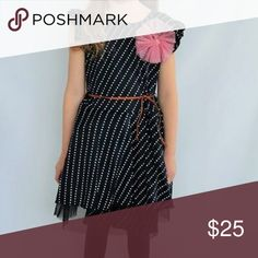 Polka Dot Dress Navy with white polka dots. Ruffles sleeve. Comfy fit. Tulle layer for a nice poof. Accent bow flower and tie belt. Dresses