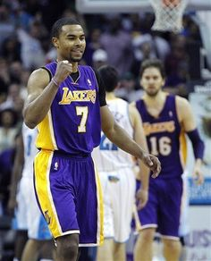 d96c2609f Ramon Sessions reacts after hitting a three point shot to extend the Lakers  lead late in the second half of an NBA basketball game against the New  Orleans ...
