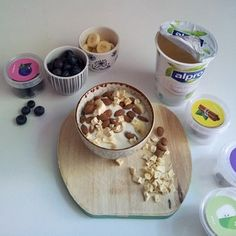 Alpro soya yoghurts with various toppings - fruit (banana, raspberry, peach…