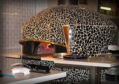 tiled pizza oven---wouldn't want to tile though. just stucco