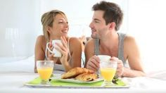 Cheerful young couple having breakfast in bed - HD stock footage clip