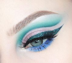 """New tutorial LINK IN BIO  from @makeupgeekcosmetics Light Year Sparkler, Peacock, Dragonfly, Shore Thing, Corrupt & Motown shadows  @anastasiabeverlyhills Macaron shadow on the lid  @nyxcosmetics Teal Glitter over NYC liquid liner. And Ash Brown Micro Brow Pencil  @sheamoisture4u Blue liner pencil  @lashesbylena """"Lala"""" lashes  @misaki_cosmetics Natsumi Grey lens (use code BECCA) must register account to use the discount & code applies to orders $30+  #beccaboo318"""