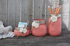 Rustic mason jar desk set. Hand painted in coral, lightly distressed, tied with jute and ivory colored roses, finished with a protective coating. Accessorize your desk with a place to keep pencils, pe