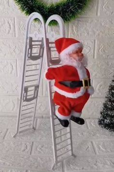 We just can't get enough of it! This ladder climbing Santa is a perfect companion to any Christmas tree! If you're looking for Santa that will bring some more spark to your home and Christmas tree - Look No More!
