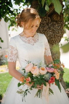 Modest lace wedding dress. Boatneck and lace sleeves from Avenia Bridal