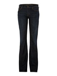 Well fitting denim in an understated (probably dark) wash - avoid artificial distressing until you are more confident at recognizing good distressing. (Think high school jeans on an adult woman, eugh) Leg opening size fluctuates over generations. Tapered jeans were hot in the 80's, then flare and bootcut got big, now skinny jeans are back again. Figure out what's best for you to stay comfortable and trendy.     CITIZENS OF HUMANITY  Amber Mid Rise Boot Cut Jean