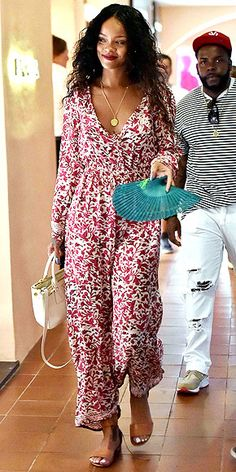 And for those of you not quite ready to admit summer is almost over, we present you with this look. Rihanna wears a laid-back floral-print Natalie Martin maxi (those long sleeves and the red shade means it'll transition well into fall), taking it up a notch with a matching lip and a structured Prada bag.