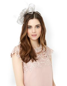 Perfect race day and wedding looks with our Marni band fascinator, ornamented with a statement metallic bow with feather tendrils.