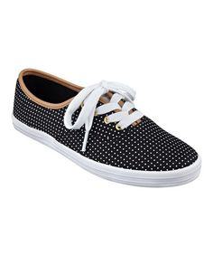 This Black & White Polka Dot Tahlor Sneaker by Tommy Hilfiger is perfect!
