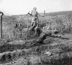 Frozen in time - two Russian soldiers, caught in barbed wire and turned into easy targets for the Austro-German forces.