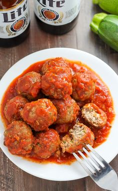 Juicy and flavorful turkey meatballs swimming in a sea of homemade marinara sauce. Baked and ready in about 30 minutes. Turkey Recipes, Meat Recipes, Healthy Dinner Recipes, Turkey Meals, Whole30 Recipes, Meatball Recipes, Healthy Dinners, Turkey Zucchini Meatballs, Baked Turkey