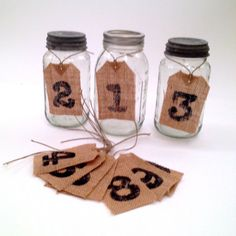 These table numbers are made with hand cut rustic burlap.  The attached jute twine make these ideal to hang on wine bottles or mason jars.  ...