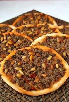 "These ""Arab pizzas"" called lahm bi ajin (or sfiha) date back to the fifteenth century and would have appeared in the region of the Beqaa Valley in Eastern Lebanon. Lebanese Cuisine, Lebanese Recipes, Turkish Recipes, Ethnic Recipes, Arabic Recipes, Lebanese Meat Pies, Lebanese Chicken, Syrian Recipes, Albanian Recipes"