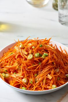 A recipe for easy carrot slaw tossed with a tangy Dijon mustard dressing.