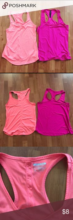 Lot of 2 Pink Workout Yoga Racerback Tank Tops Lot of two pink Workout tops. Both are large. Excellent condition aside from one small snag on the dark pink one. Tops Tank Tops