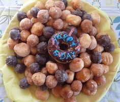 """DIY Dunkin' Donut Cake! I think this is a great idea for kids birthday parties (Don't get me wrong, I love my fair share of munchkins) but this is a very cute and easy way to celebrate with the """"chillens"""". :)"""