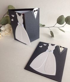 Mr and Mrs wedding Card. Dress shaped wedding card. From the Bride. To my fiance. Parents of the Bride and Groom. Thank you Wedding Card    This listing is for one (1) Wedding Gown / Tuxedo card    Card measures approx: 4 ¼ x 5 ¼ closed 10 x 5 ¼ opened.  Card ships with envelope via USPS within 3-5 days of ordering This card is handmade using a pearl black card stock paper. The wedding dress is created using pearl white and textured white papers. Ribbon and a gem have been added to the…