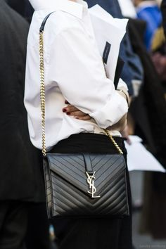 monochrom outfit. Black Saint Laurent bag and white shirt