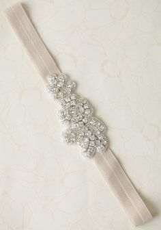 Mia Jolie Indie Headband In Cream 24.99 at shopruche.com. Add radiant sparkle to any look with this cream-toned headband featuring an intricate silver-toned rhinestone and bead applique design.0.6
