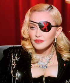 GREGORY KARA - wearing Red leather eyepatch made by moi at for the debut video world premiere . Divas, Ted White, Cat Eye Sunglasses, Mirrored Sunglasses, Lady Madonna, Material Girls, Female Singers, Kara, Mtv