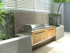 Create a functional and attractive outdoor kitchen and entertaining area with tile.