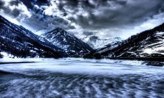 Chasing the storm - From the dam in Pontechianale, Italy. Overt the mountains there is France separated from Italy by Colle dell'Agnello. At the bottom of the frame you can see the lake frozen by snowfall