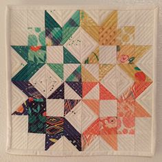 I used a mini charm pack with this pattern: http://www.unitednotions.com/Moda-Love-Layer-Cake-Quilt.pdf got the idea from https://www.arabesque-scissors.com/2017/08/aussie-mini-quilt-swap-barn-style-quilt/