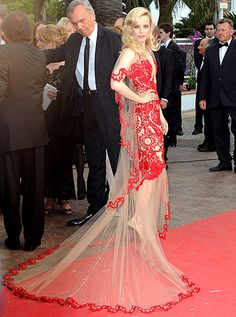 Ravishing in Red Lace  At the May 2011 Cannes premiere of Woody Allen's Midnight in Paris, the Canadian beauty played peekaboo in a tulle dress covered in strategically placed red lace by Marchesa. Bombshell waves and a nude lip finished the look.