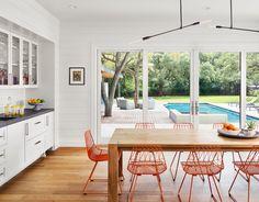 Loving Bend's orange chairs here. Architect: Stuart Sampley Architect; Interior design: Greer Interior Design; Photo by Casey Dunn