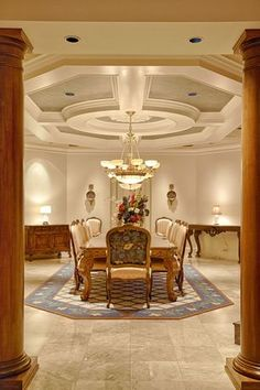 Luxury dining room with in neutral colors, high ceilings and travertine floor #travertine #floor #home #interior #naturalstone #decor