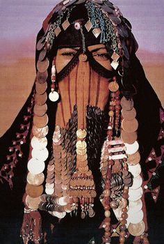 A Bedouin woman with a spectacularly adorned face veil in Sinai, Egypt.