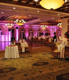 wedding venue lighting by Spinners Entertainment: Ambient Room LED Uplighting is one of the newest lighting enhancements offered by Spinners Entertainment. Imagine the walls of your reception facility tastefully splashed with the subtle accent color of your flowers or bridesmaid dresses.