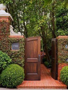 Don't know where this is or what it leads to, but I love the idea of interior paneled doors as an exterior gate.