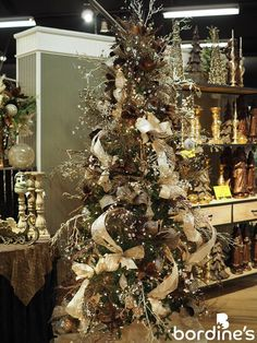 """""""Toasted Chestnuts""""- Dark brown artificial flowers with gold ribbon and accents Christmas Tree Store, Christmas Tree Design, Beautiful Christmas Trees, Christmas Tree Themes, Elegant Christmas, Outdoor Christmas Decorations, Gold Christmas, Rustic Christmas, Christmas Home"""