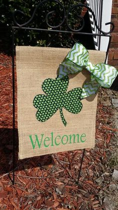 St. Patrick's Day burlap Shamrock flag with glitter chevron bow. Welcome your guests with a fun flag handmade by Modern Butterfly.
