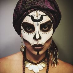 Cool Halloween makeup idea: Voodoo Priestess! This is a cool twist on the classic sugar skull make up IMO!