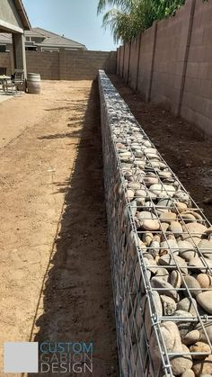 Gabion baskets and Gabion wall design, we create beautiful landscape features in Phoenix, AZ with wire baskets filled with rock. Gabion Stone, Gabion Retaining Wall, Landscaping Retaining Walls, Stone Fence, Gabion Fence Ideas, Gabion Wall Design, Fence Design, Backyard Fences, Backyard Landscaping