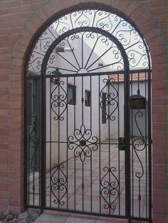 Beautiful gate with arch www.realsec.co.za Door Grill, Wrought Iron Doors, Iron Work, Iron Gates, Classic Elegance, Exterior Doors, Entrance, Arch, Stairs