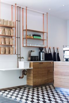 Love the Uber, copper piping for the sinks carried on to the shelving