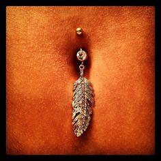 Feather bellybutton ring... Wish I still had mine pierced